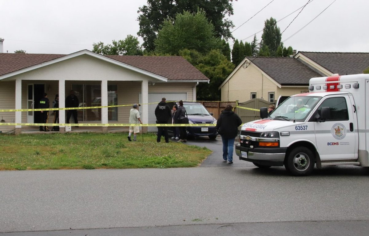 Police and ambulance outside a home in Maple Ridge where family and the Independent Investigations Office say a person was shot by police Aug. 11, 2019.