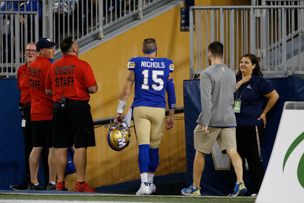 Winnipeg Blue Bombers quarterback Matt Nichols (15) leaves the field with an upper body injury against the BC Lions in the second half of CFL action in Winnipeg Thursday, August 15, 2019.