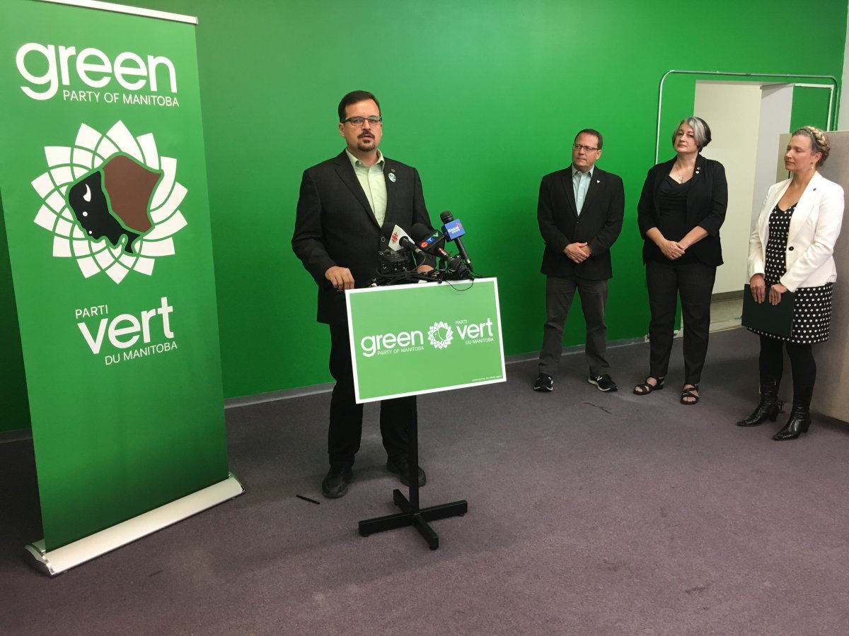 Green Party Wolseley Candidate David Nickarz speaks about proportional representation, flanked by other Green Party officials. Michael Draven/Global News.