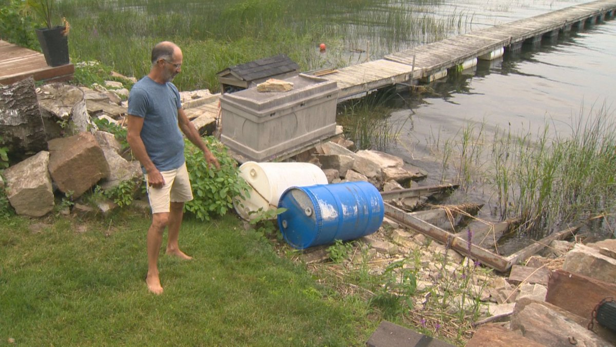 André Grand-Maison shows where the water level is at his home in Notre-Dame-de-l'Île-Perrot. Tuesday, August 06, 2019.