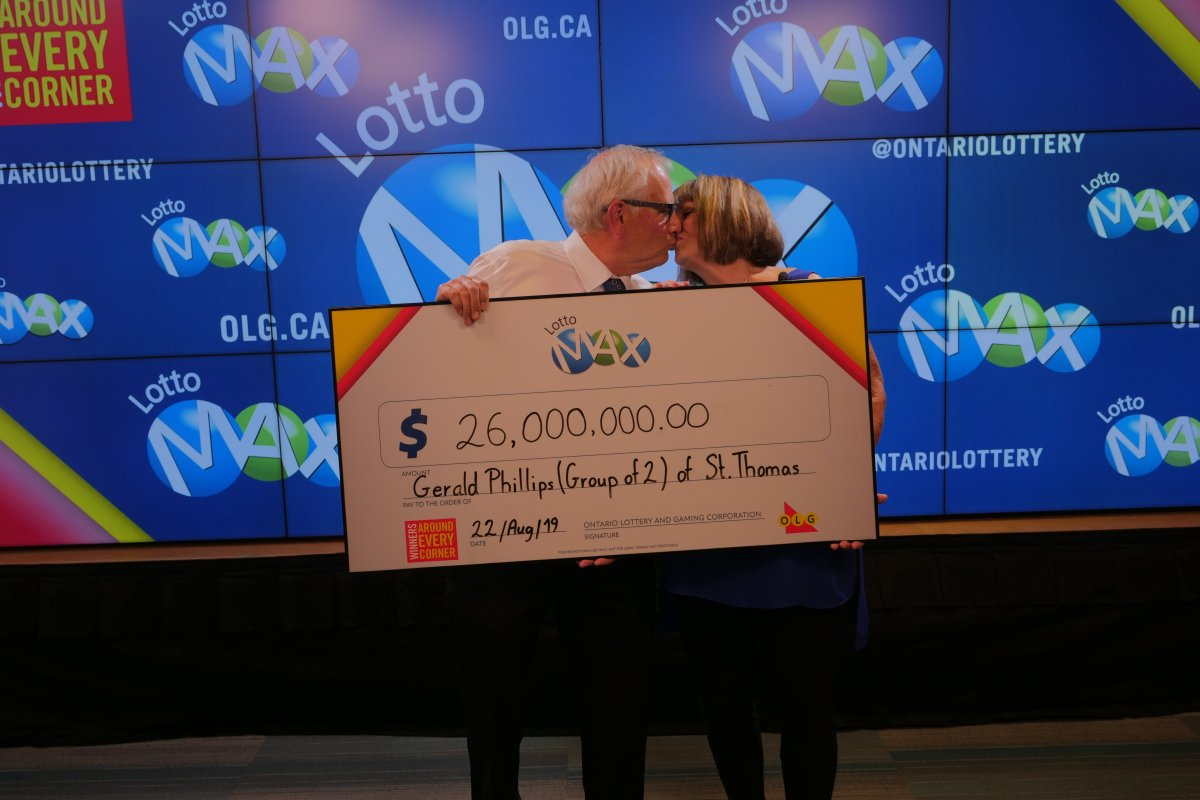 The $26-million winners share a smooch, celebrating their mega Lotto Max win.