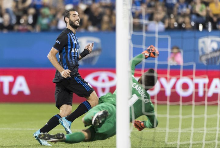 Montreal Impact's Ignacio Piatti scores against Cavalry Fc's goalkeeper Marco Carducci during second half semifinal Canadian Championship soccer action in Montreal, Wednesday, August 7, 2019.