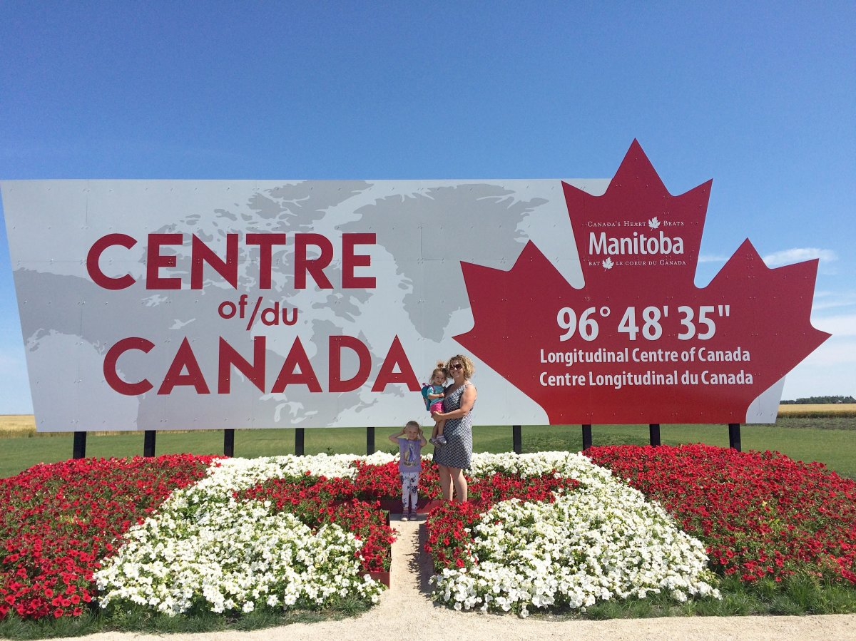 Carmen Kaephler and her daughters at the longitudinal centre of Canada in the RM of Tache. Kaephler has created a list of 101 Manitoba roadside attractions.