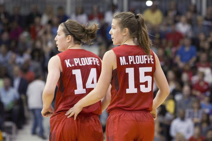 Michelle Plouffe (right) jogs back to her defensive position with sister Katherine during women's basketball action against Argentina at the Pan Am games in Toronto on Friday, July 17, 2015. Katherine and Michelle Plouffe raised some eyebrows when they announced their retirement from Canada's women's basketball team earlier this year.