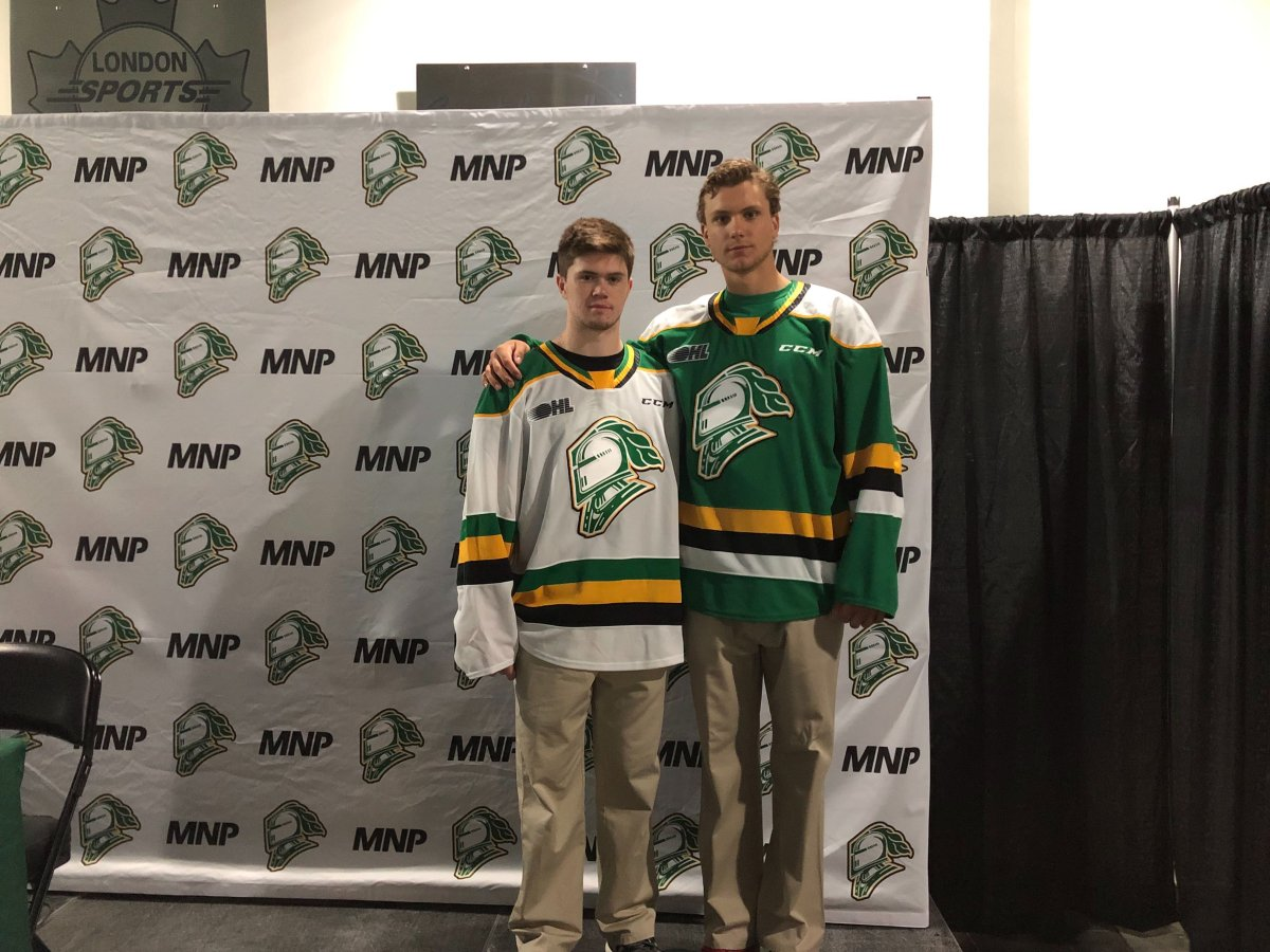 Connor McMichael, left, and Alec Regula pose with the London Knights' jersey for the 2019-2020 season.
