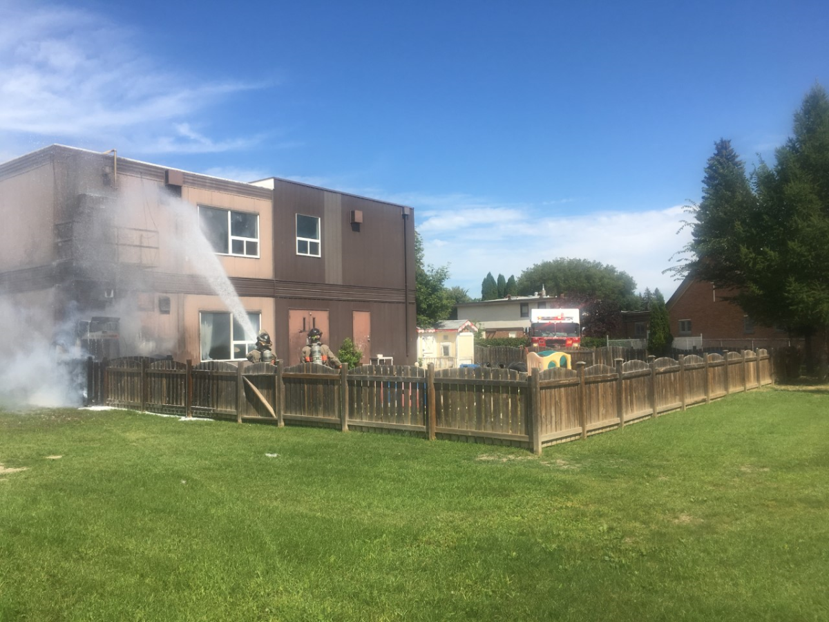 Saskatoon firefighters said flames were coming from the corner of the building and a fence at the St. Francis School daycare when they arrived.