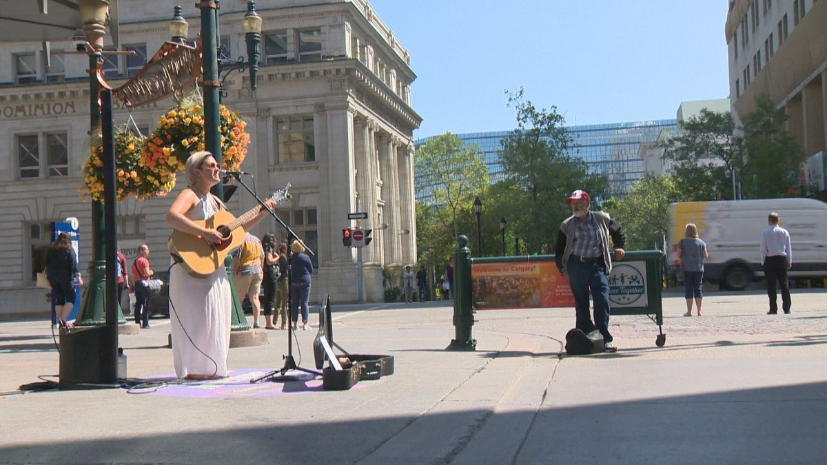 An artist performs on Calgary's Stephen Avenue on Thursday, August 1.