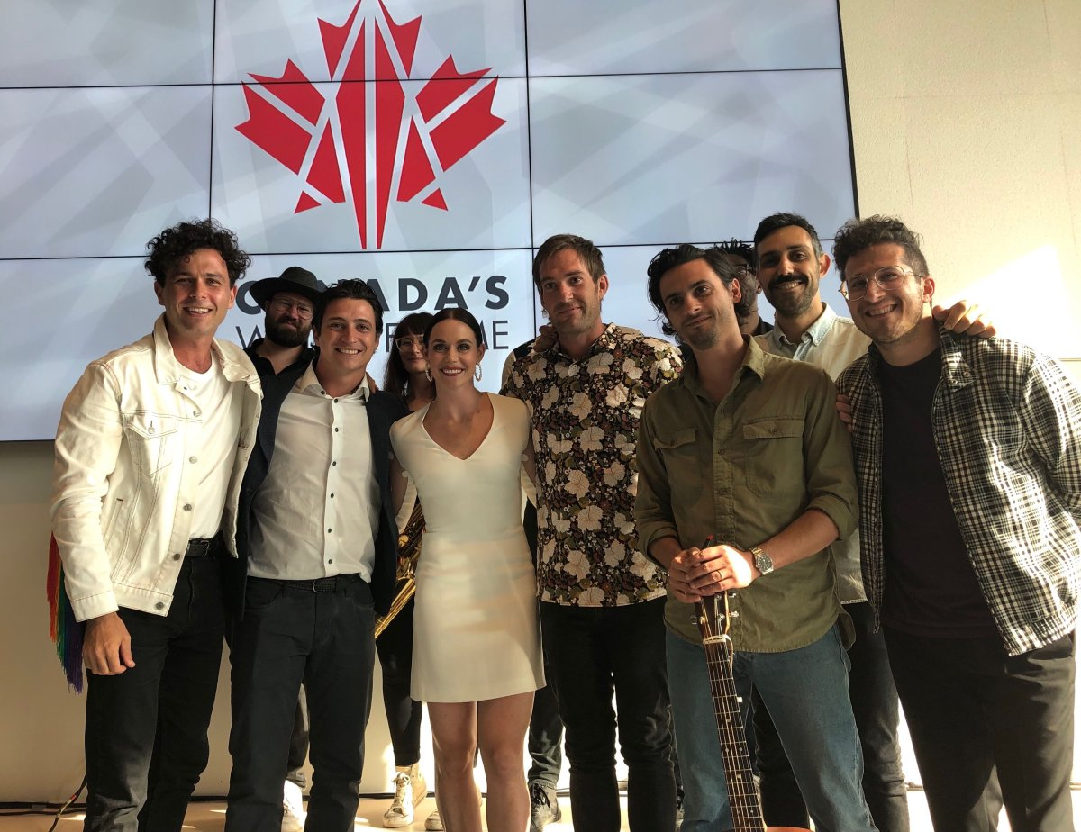 Scott Moir, second from left, and Tessa Virtue, third from left, are joined by Hamilton rock band Arkells during a celebration of the figure skating pair's spot on Canada's Walk of Fame in London, Ont.