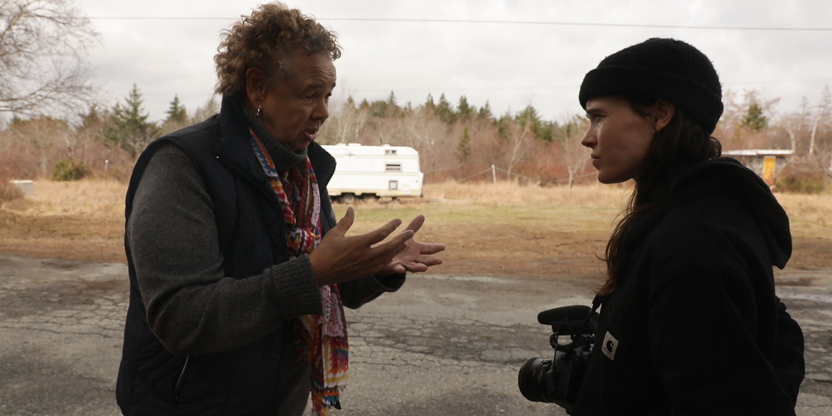 Louise Delisle speaking to Ellen Page about the impact of environmental racism on her community in Shelburne, N.S.