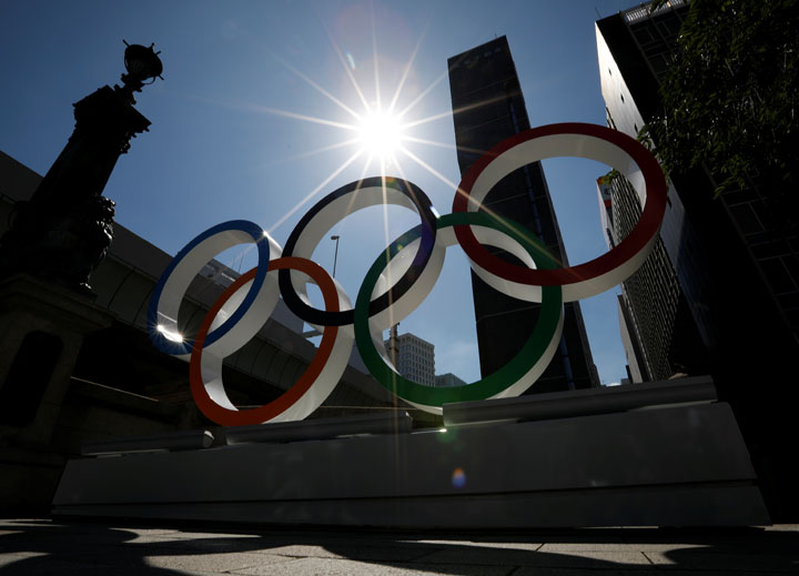 Summer sunshine is seen through Olympic rings displayed at Nihonbashi district in Tokyo, Japan August 5, 2019.