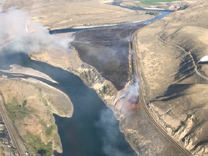 A grass fire burning 16 kilometres east of Cache Creek, near the Trans-Canada Highway, was listed at approximately 41 hectares in size late Monday.
