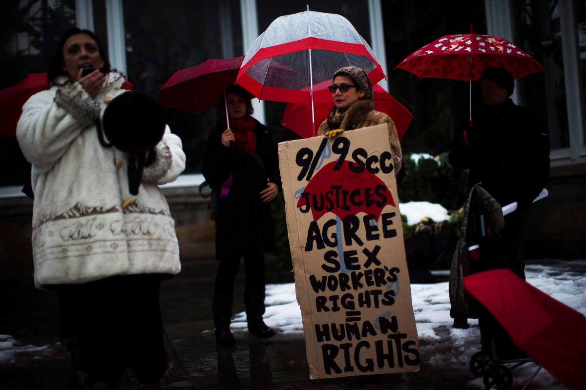 Protestors are seen during rally at Allan Gardens in Toronto.