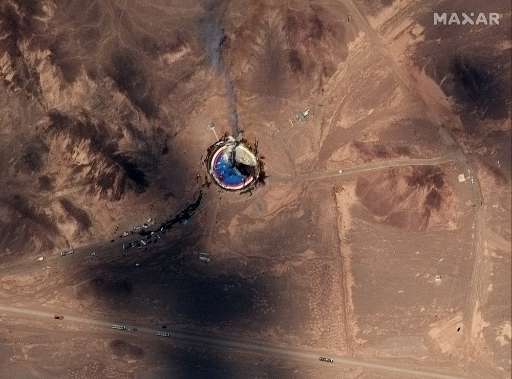 This satellite image from Maxar Technologies shows a fire at a rocket launch pad at the Imam Khomeini Space Center in Iran's Semnan province, Thursday, Aug. 29, 2019. Satellite images released Thursday show the smoldering remains of a rocket at a Iran space center that was to conduct a U.S.-criticized satellite launch.
