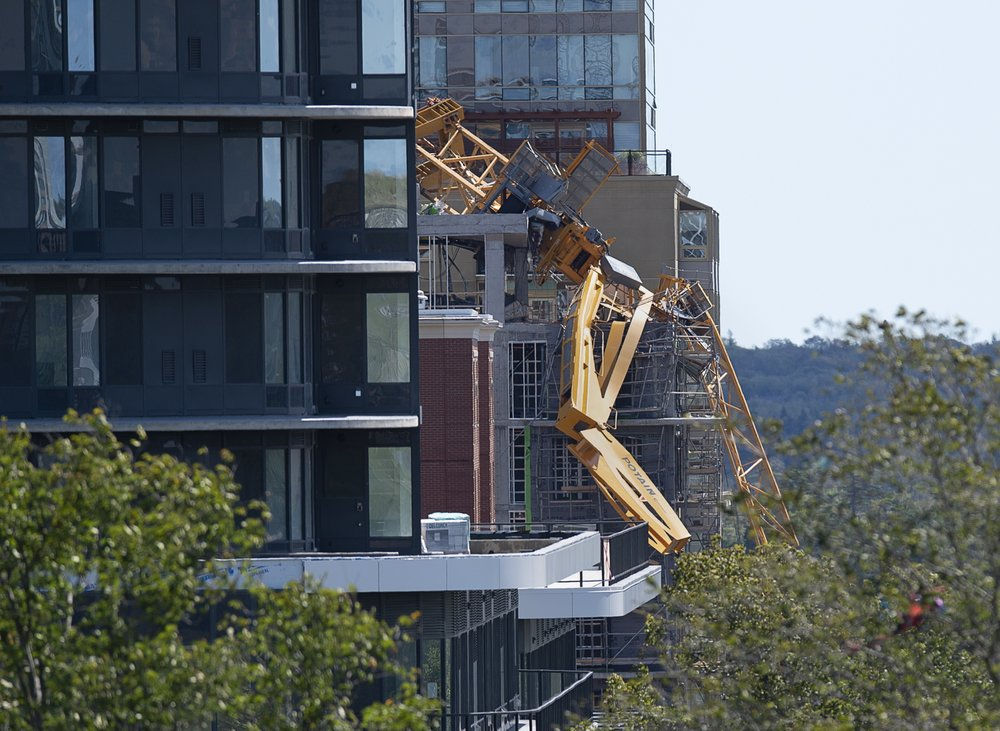 The twisted remains of a building crane hang off a construction project in Halifax Nova Scotia in the wake of Dorian, Sunday, Sept. 8, 2019.