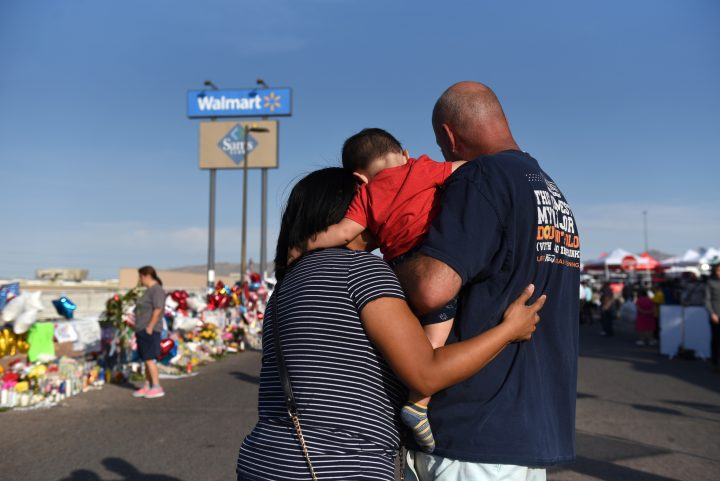 Norma, Luke and Mark Jimerson pay their respects at a memorial four days after a mass shooting at a Walmart store in El Paso, Texas, U.S. Aug. 7, 2019.
