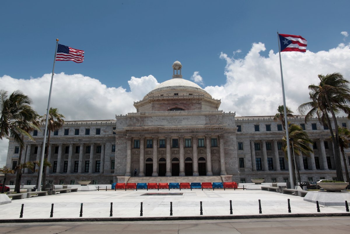 The flags of the U.S. and Puerto Rico fly outside the Capitol building in San Juan, Puerto Rico, May 4, 2017.