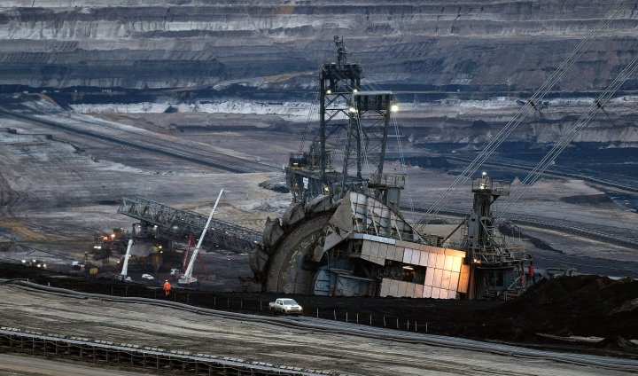 Giant bucket wheels produce brown coal at the open pit mining Garzweiler in Jackerath, Germany, Friday, Dec. 7, 2018.