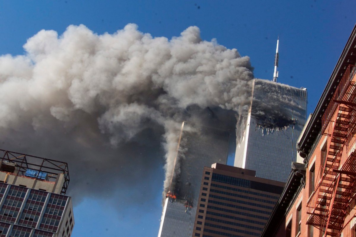 Smoke rises from the burning twin towers of the World Trade Center after hijacked planes crashed into the towers in New York City on Sept. 11, 2001.