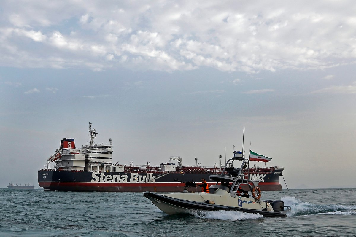 An Iranian Revolutionary Guard jet boat sails around the seized British-flagged tanker Stena Impero in Bandar Abbas, southern Iran, July 21, 2019.