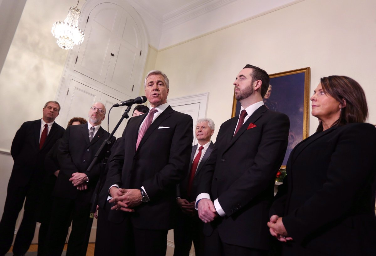 Newfoundland and Labrador Liberal Party Leader Dwight Ball, joined by members of his cabinet, Gerry Byrne, left to right, Perry Trimper, Eddie Joyce, Andrew Parsons and Siobahn Coady, speaks with the media after being sworn in as the province's 13th premier at Government House, in St. John's, N.L., on Monday, Dec. 14, 2015. Ball shuffled his cabinet in St. John's this morning, moving the former provincial Speaker to a cabinet position.