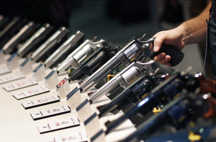 In this Jan. 19, 2016 file photo, handguns are displayed at the Smith & Wesson booth at the Shooting, Hunting and Outdoor Trade Show in Las Vegas. There's no mechanism under federal law to seize firearms from people who have become prohibited to purchase or possess one.