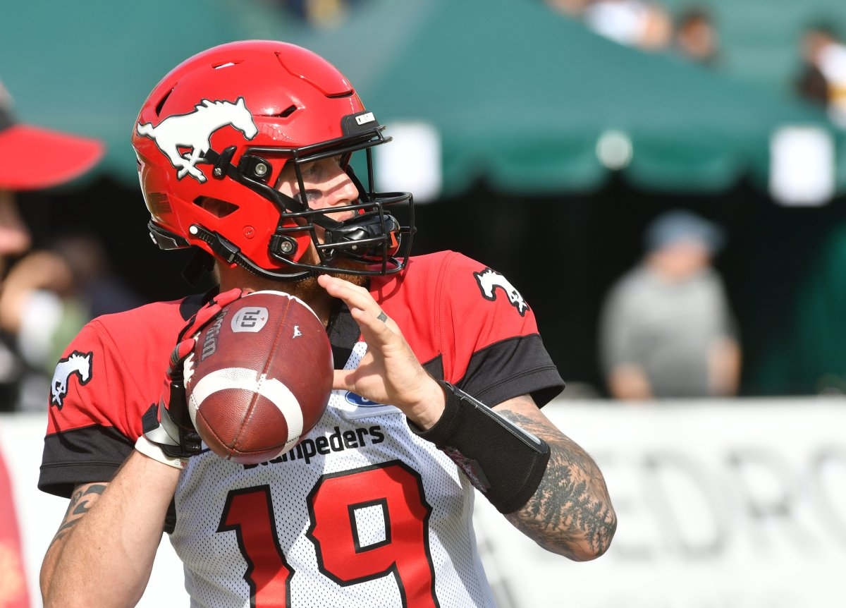 Calgary Stampeders player #19 (QB) Bo Levi Mitchell gets ready to throw the ball as the Edmonton Eskimos take on the Calgary Stampeders during the pre-game warm-up before the first half half of CFL game action at the Brick Field located at Commonwealth stadium in Edmonton Saturday, September 07, 2019.