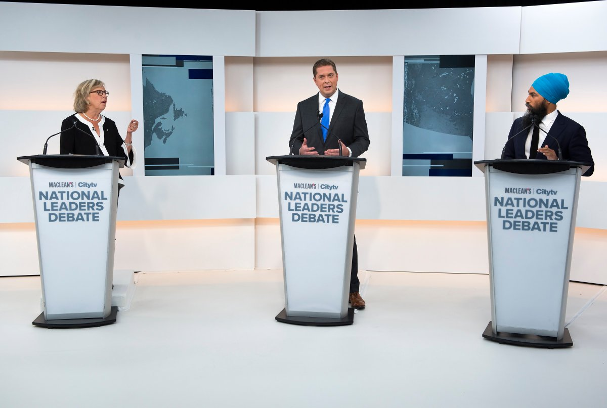 Green Party Leader Elizabeth May, left, Conservative Leader Andrew Scheer, centre, and NDP Leader Jagmeet Singh take part during the Maclean's/Citytv National Leaders Debate in Toronto on Thursday, Sept. 12, 2019.