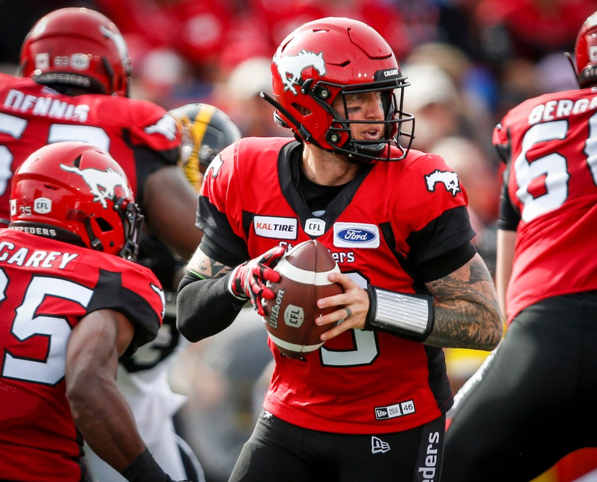 Calgary Stampeders quarterback Bo Levi Mitchell looks for a receiver during second half CFL football action against the Hamilton Tiger-Cats in Calgary, Saturday, Sept. 14, 2019.