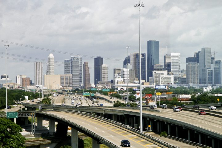 Cars travel along a highway with the skyline of downtown Houston in the background on May 20, 2010.