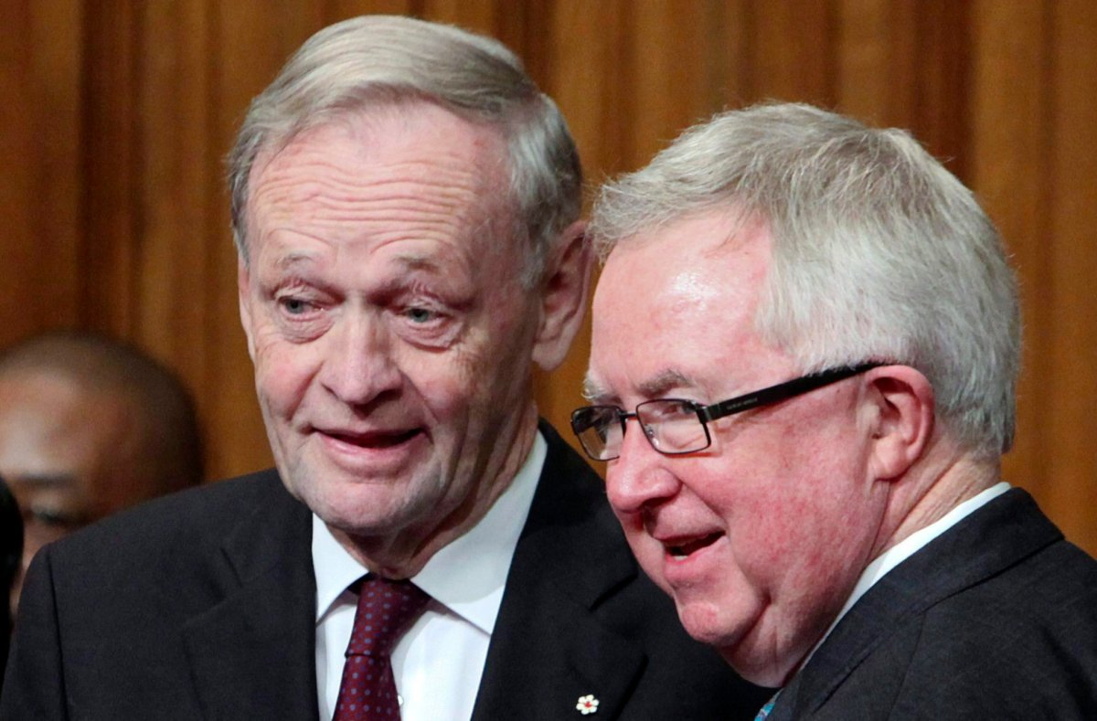 Former prime ministers Jean Chretien and Joe Clark chat following the installation ceremony David Johnston as Canada's 28th Governor General in the Senate on Parliament Hill, Friday, Oct. 1, 2010, in Ottawa.