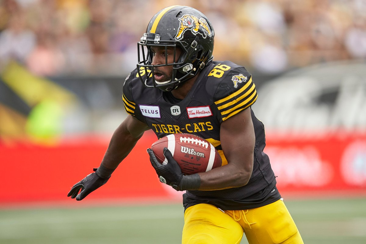 Hamilton's Bralon Addison runs the ball during the third quarter of the CFL's Labour Day Classic between the Ticats and the Toronto Argonauts in Hamilton, Ontario on Monday, September 2, 2019.