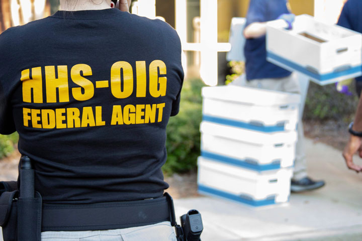 In this photo provided by the Department of Health and Human Services Office of the Inspector General, federal agents from the HHS Office of Inspector General prepare for operations targeting individuals allegedly involved in genetic testing fraud in the Atlanta region, Friday morning, Sept. 27, 2019.
