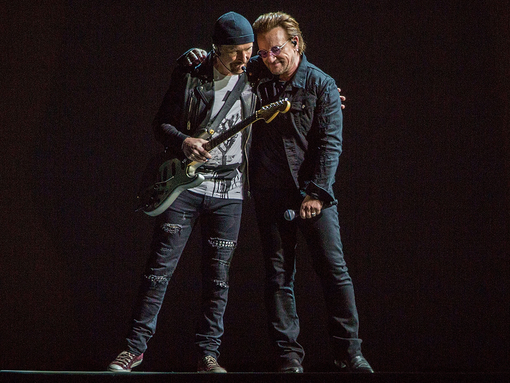 The Edge (L) and Bono of U2 perform on stage on the final night of 'U2: The Joshua Tree tour' at SDCCU Stadium on Sept. 22, 2017 in San Diego, Calif.