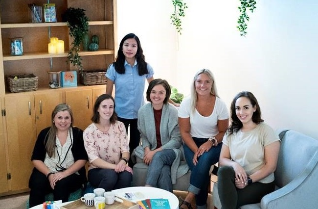 Brescia's wellness peers and their staff advisers in the university's new peer support space.