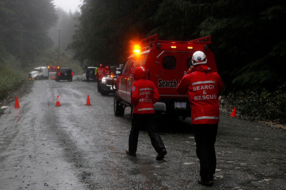 Search and rescue crews and RCMP help a tow truck crew remove a bus from the ditch of a logging road near Bamfield, B.C., on Saturday, Sept. 14, 2019.