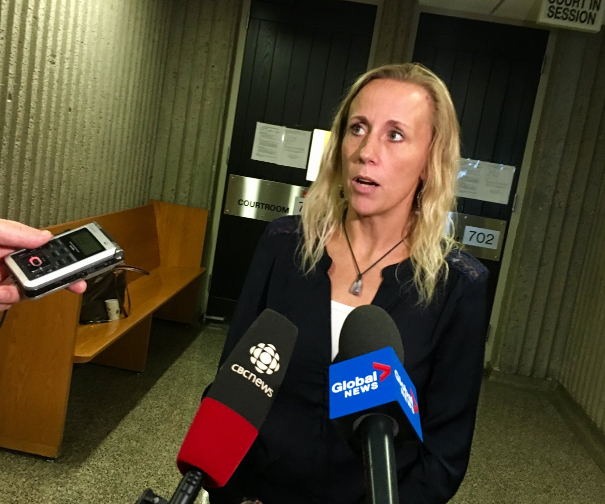 Carrie Low speaks with reporters following an appearance in Nova Scotia Supreme Court where her legal team is seeking a judicial review into the police's handling of her sexual assault case.