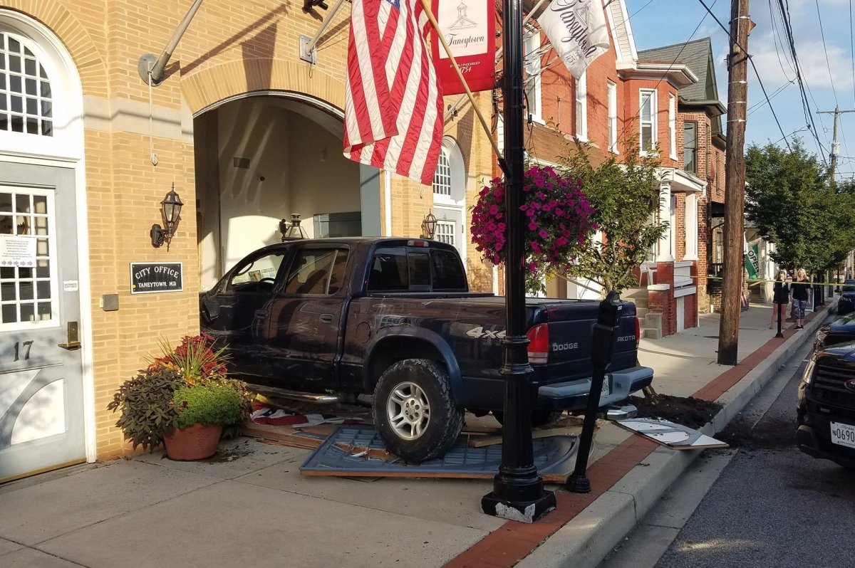 A pickup truck is shown after crashing into city hall in Taneytown, Md., on Aug. 30, 2019.