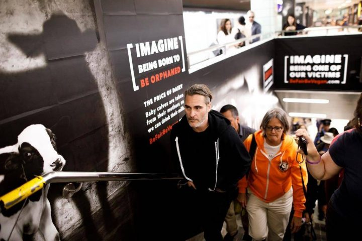 Actor Joaquin Phoenix tours a vegan ad campaign inside a subway station in Toronto, Monday, Sept. 9, 2019.