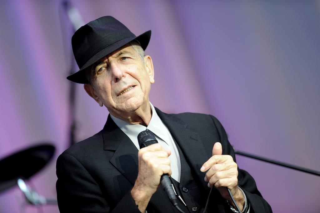 FILE - In this Aug. 18, 2010 file photo, singer Leonard Cohen performs open air at the Waldbuehne in Berlin.