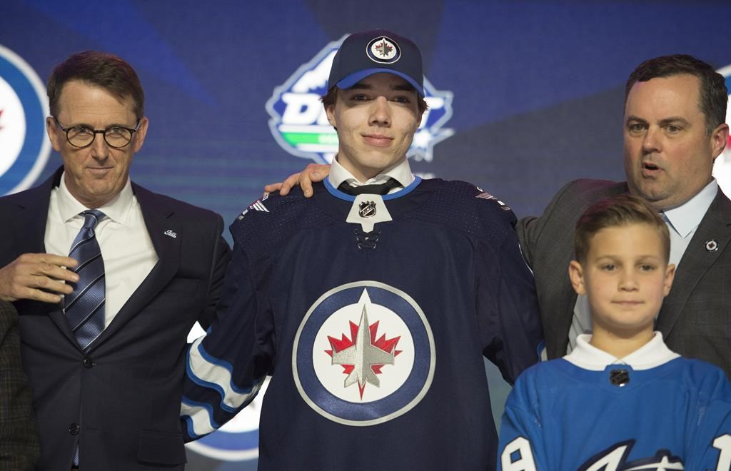Winnipeg Jets select Ville Heinola during the first round NHL draft at Rogers Arena in Vancouver, Friday, June, 21, 2019.