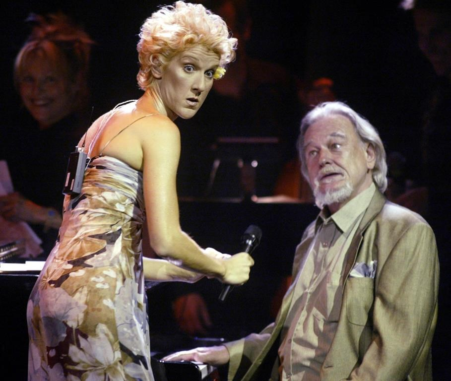 Singer songwriter Celine Dion jokes around with jazz pianist Vic Vogel at a gala event honouring songwriter Eddy Marnay, in Gatineau, Que., Wedneday, July 9, 2003. Vogel, who began playing the piano by ear at the age of five and rose to become one of Canada's jazz stalwarts, has died. He was 84.