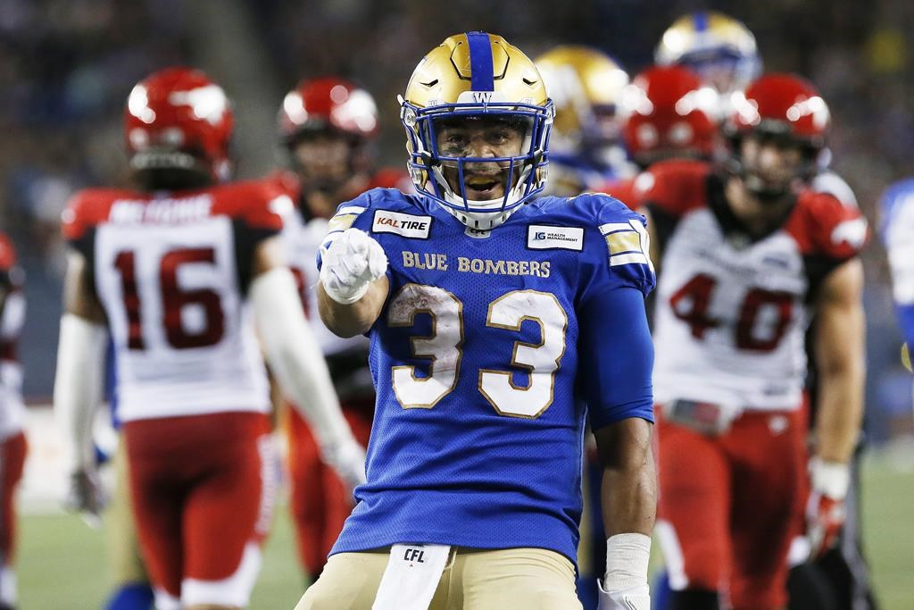 Winnipeg Blue Bombers' Andrew Harris (33) celebrates his run deep in the Calgary Stampeders' zone during the second half of CFL action in Winnipeg Thursday, August 8, 2019. THE CANADIAN PRESS/John Woods.