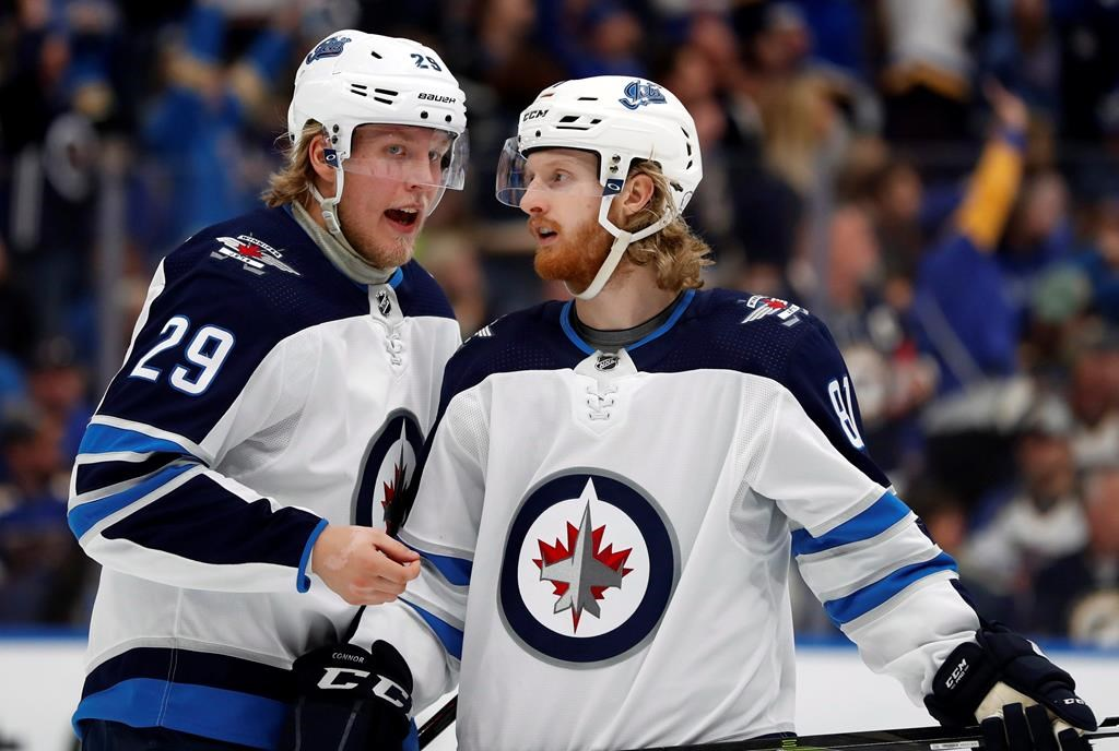 Winnipeg Jets' Patrik Laine (29), of Finland, and Kyle Connor (81) talk during the third period in Game 6 of an NHL first-round hockey playoff series against the St. Louis Blues, Saturday, April 20, 2019, in St. Louis. Laine and Connor are ready to make up for missing most of training camp by slotting onto the NHL Jets roster for the team's regular-season opener in New York against the Rangers on Thursday. THE CANADIAN PRESS/AP/Jeff Roberson.