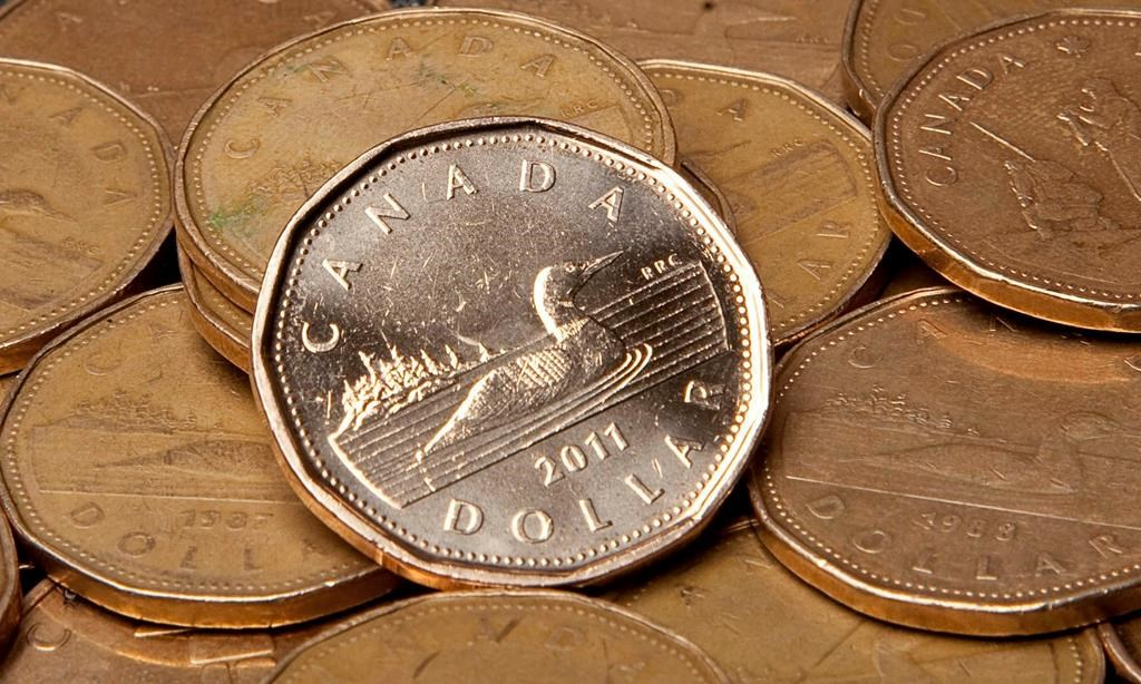 Canadian dollars are pictured in Vancouver, Sept. 22, 2011. When it comes to spending, it's often easy to overlook the small, routine expenses because they happen without requiring much thoughtTHE CANADIAN PRESS/Jonathan Hayward.