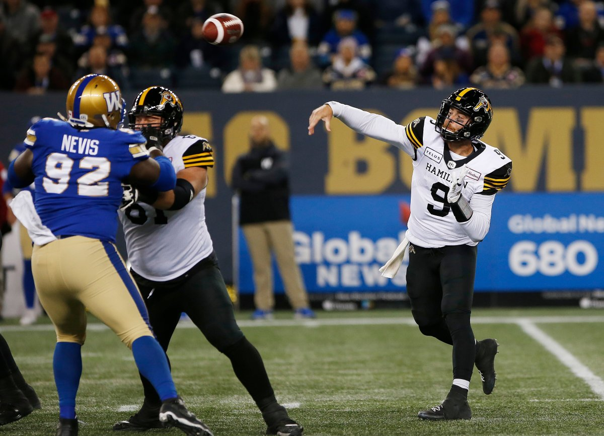 Hamilton Tiger-Cats quarterback Dane Evans (9) throws against the Winnipeg Blue Bombers during the first half of CFL action in Winnipeg on Friday, September 27, 2019.
