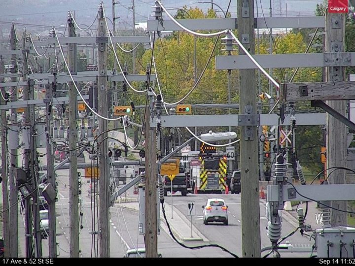 52 street south east Calgary Fire Dept truck tips over.