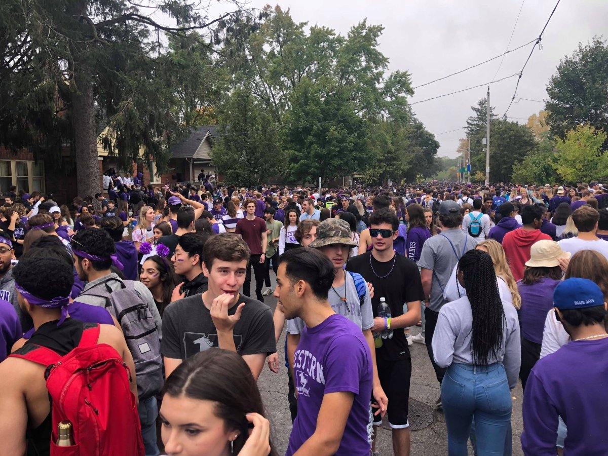 Thousands of students and partiers gather along Broughdale Avenue to celebrate 2019's unsanctioned Fake Homecoming (FOCO).