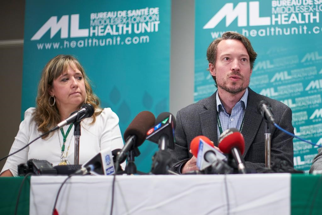 Dr. Chris Mackie, Medical Officer and CEO of Health for the Middlesex-London Health Unit speaks during a press conference in London, Ont., Wednesday, September 18, 2019 as Linda Stobo, manager, Chronic Disease and Tobacco Control at the unit looks on.