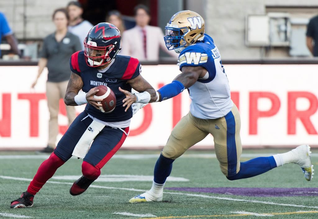 Montreal Alouettes quarterback Vernon Adams Jr., left, breaks away from Winnipeg Blue Bombers linebacker Adam Bighill during second half CFL football action in Montreal, Saturday, September 21, 2019. The CFL is reviewing the helmet-swinging incident Saturday involving Adams Jr. and Bighill.THE CANADIAN PRESS/Graham Hughes.