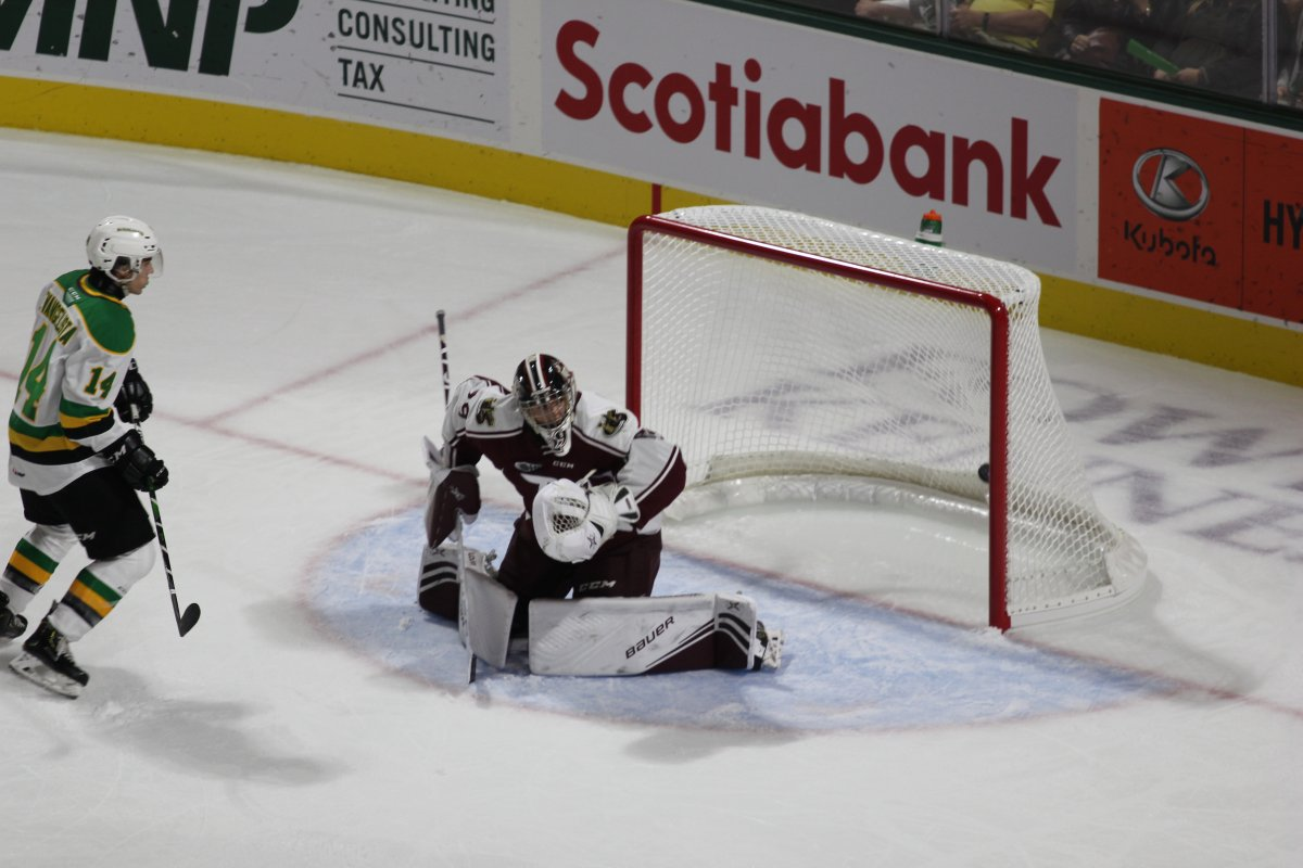 A Hunter Skinner shot finds its way past Hunter Jones of the Peterborough Petes at Budweiser Gardens on Sept. 20, 2019.